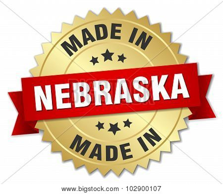 Made In Nebraska Gold Badge With Red Ribbon
