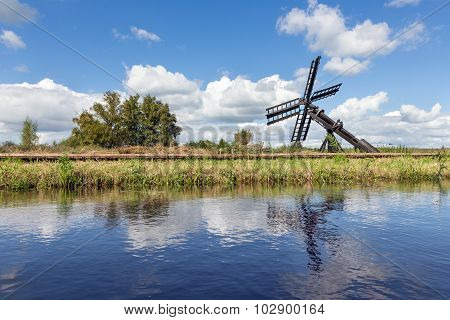 Dutch Landscape With Canal And Agriculture Windmill