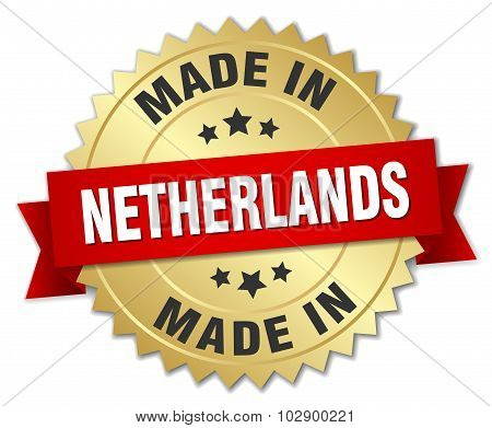 Made In Netherlands Gold Badge With Red Ribbon