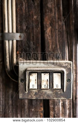 Row Of Three Grungy Electrical Switches