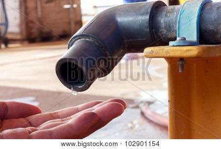 Water Is Dropping From Tap To Hand Someone.