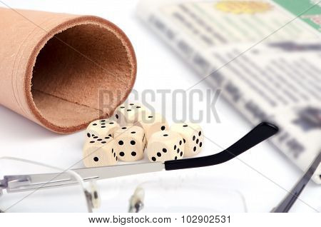 Dice, Glasses And Newspapers Still Life