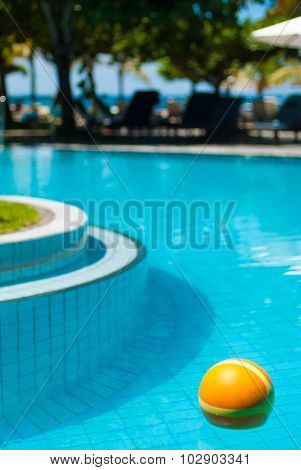 The bright yellow ball in the pool