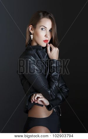Fashionable Brunette Woman In Leather Jacket