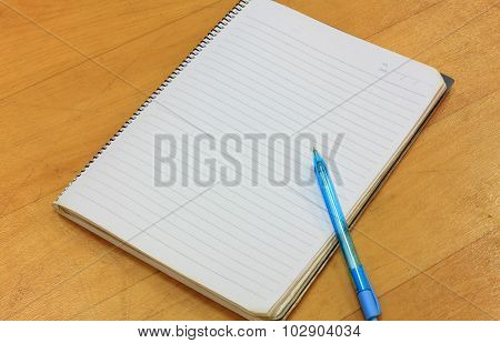 Pen,notebook On Wood Background.