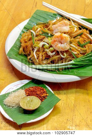 Soft Focus Thai Noodle Or Padthai With Shrimp Garnish,vegetable Lemon Sugar Chilli On Wood Backgroun