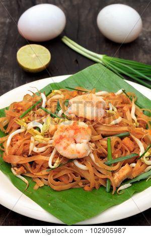 Thai Noodle Or Padthai With  Shrimp And Blur Vegetable,lemon,eggs On Wood  Background.