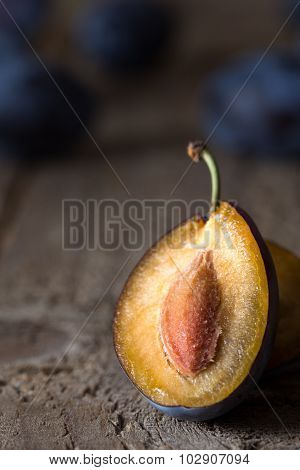 Closeup of plum on a dark wooden table