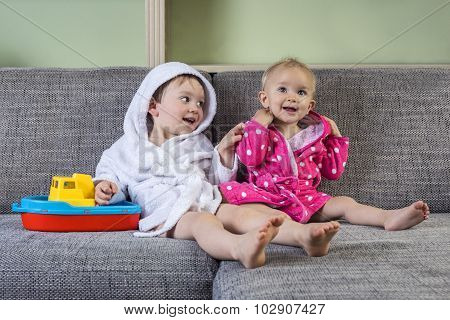 Cute Siblings In Bath Robes