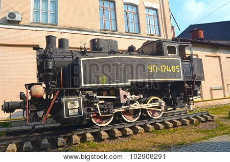 KIEV, UKRAINE - SEP 2, 2015: The monument of Soviet steam locomotive near Technical History Museum of National Polytechnic University on September 2, 2015 in Kiev, Ukraine