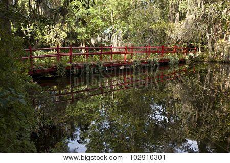 Bright, red bridge in the garden in Charleston, South Carolina