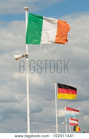 Plenty Of Flags, Italian, German Under Blue Sky