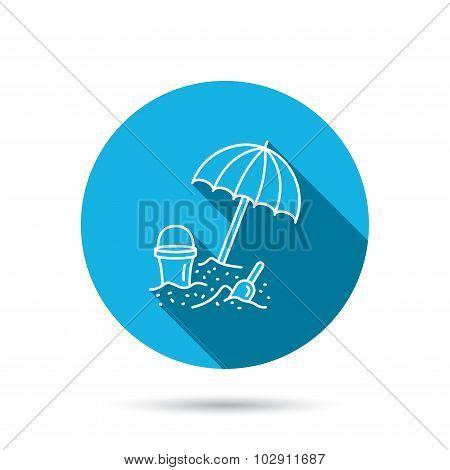 Beach umbrella in sand icon. Bucket with shovel.