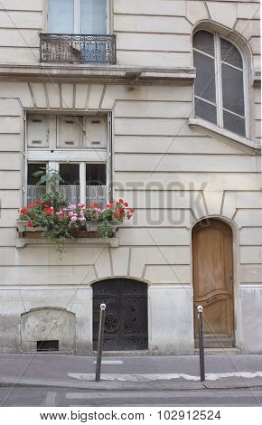 Paris street in summer, flower pot, door and windows