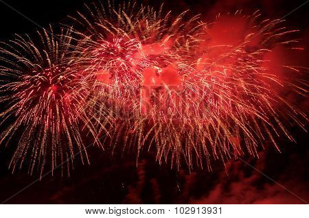 Red Fireworks On The Night Sky