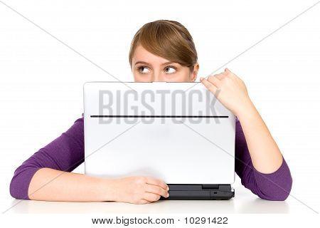 Girl Looking Behind Laptop