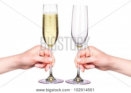 Hand with glasses of champagne isolated on a white
