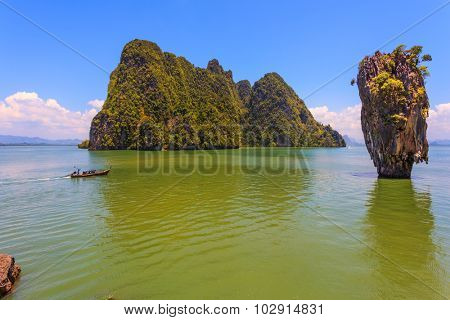Fine rest in Thailand by native boats. The gulf in the Andaman Sea. James Bond's island in the form of a vase