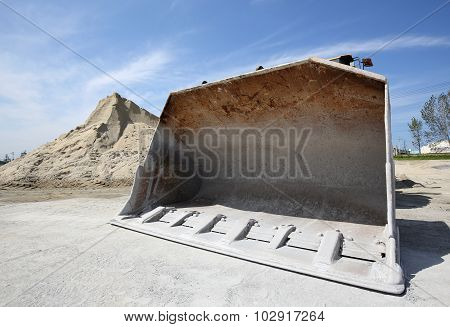 bulldozer with sand mound