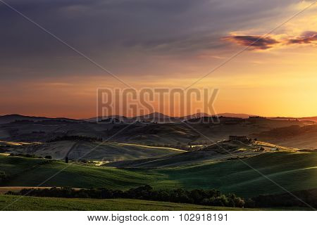 Tuscany Spring, Rolling Hills On Sunset. Volterra Rural Landscape. Green Fields And Farmlands. Italy