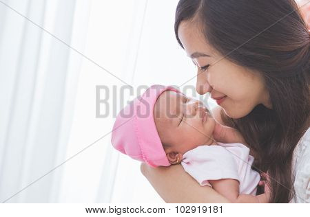 Woman Holding Her Baby Girl, Close Up