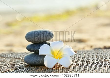 Spa stones with flower outdoors