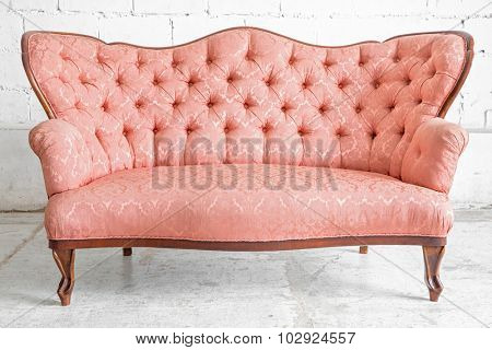Pink classical style sofa couch in vintage room