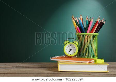 Back to school template on green chalkboard background