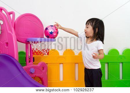 Asian Chinese Little Girl Playing Basketball