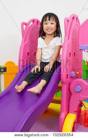 Asian Chinese Little Girl Playing On The Slide