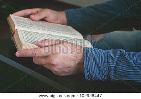 Man Reading An Old Book Closeup