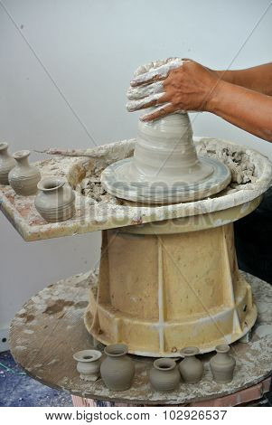 Potter make the traditional water storage containers a.k.a. Labu Sayong