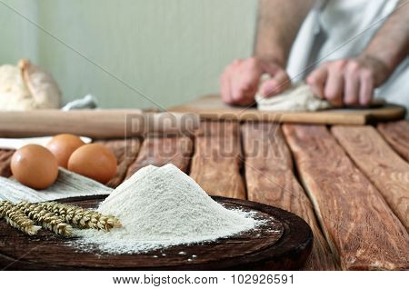 Handful Of Flour On A Rustic Kitchen