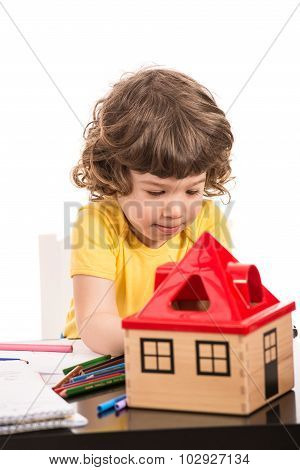 Toddler Boy Drawing At Table