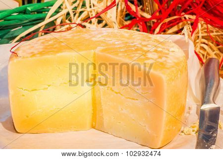 Sliced Hard Italian Cheese Pecorino On The Table