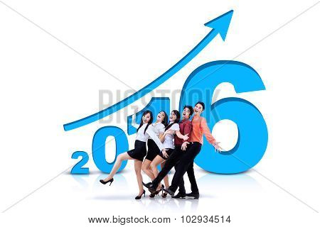 Businessteam With Numbers 2016 And Upward Arrow