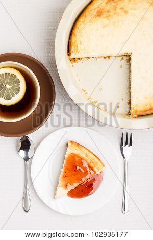 Wedge Of Homemade Cheesecake With Tea