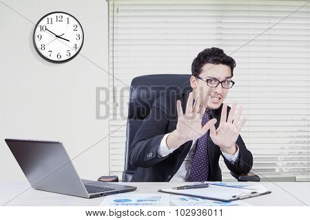Fear Businessman With Hand Gesture In Office
