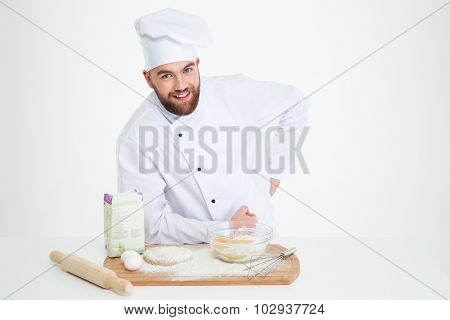 Portrait of a happy male chef cook baking isolated on a white background