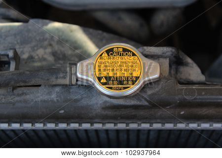 The Radiator Cap Under The Hood Of The Car