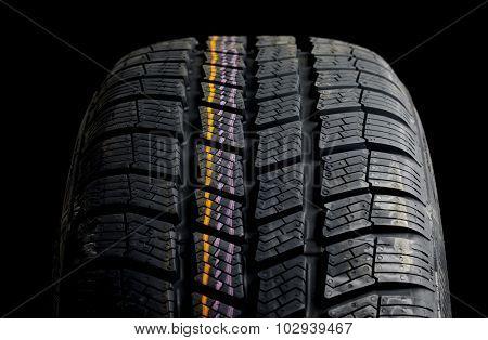 Winter tyre closeup, dark backgroud