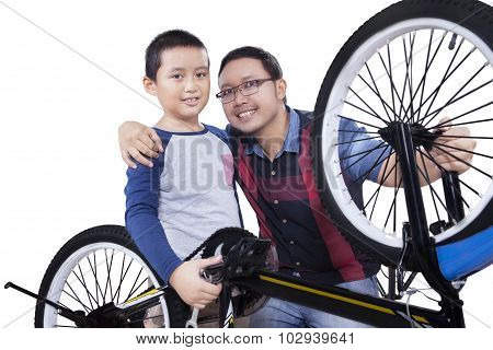 Little Boy And His Dad After Fixing A Bike
