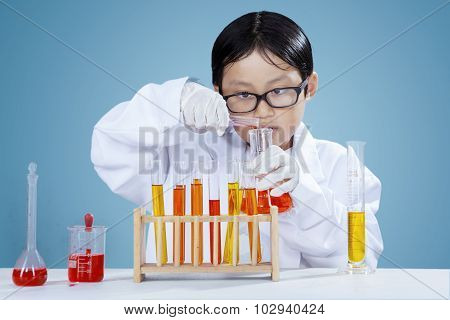 Male Chemist Doing Research With Chemical Fluid