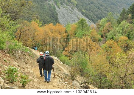 Backpackers Hiking On The Path In Mountain