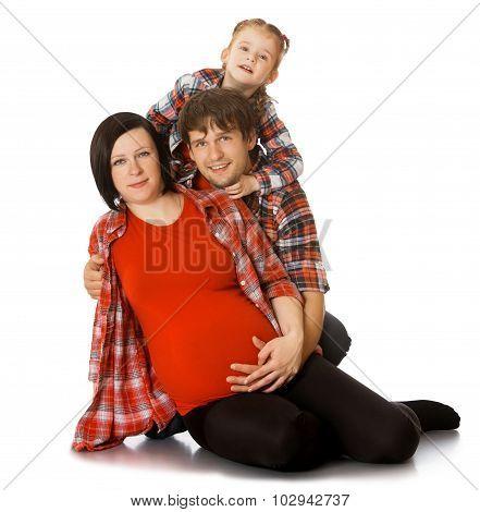Family hugging pregnant mom