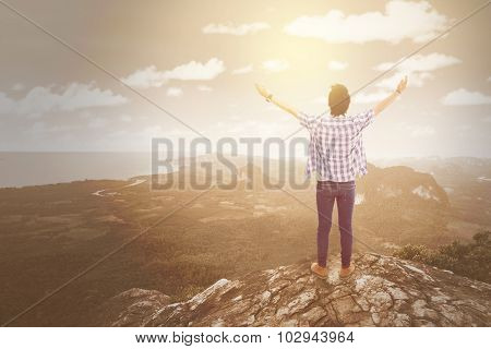 Man Standing At The Cliff Edge
