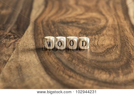 Word wood on wooden cubes