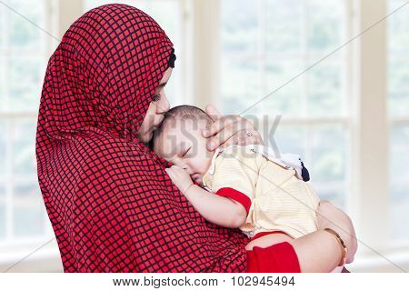 Muslem Woman And Her Baby At Home
