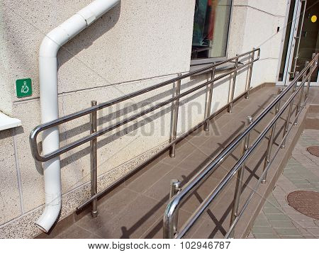 Ramp For Physically Challenged With Metal Railing
