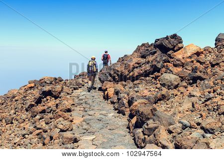 Unidentified tourists are walking on the top of El Teide Volcano Tenerife Spain